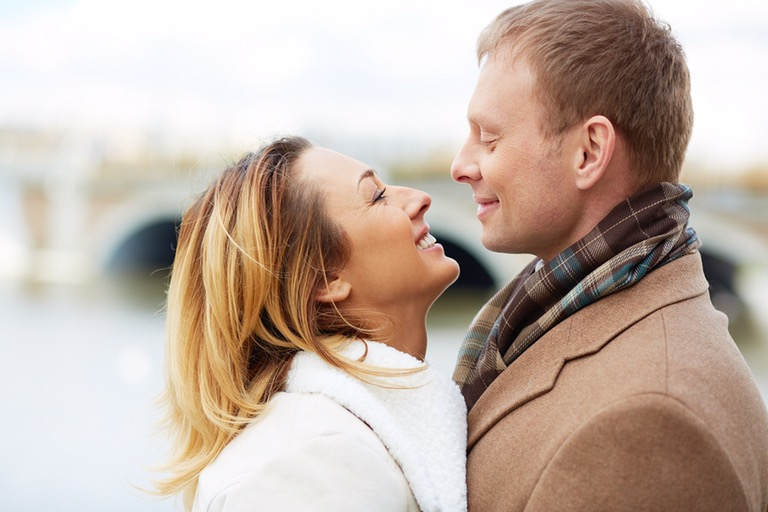 Portrait of affectionate couple looking at one another outdoors