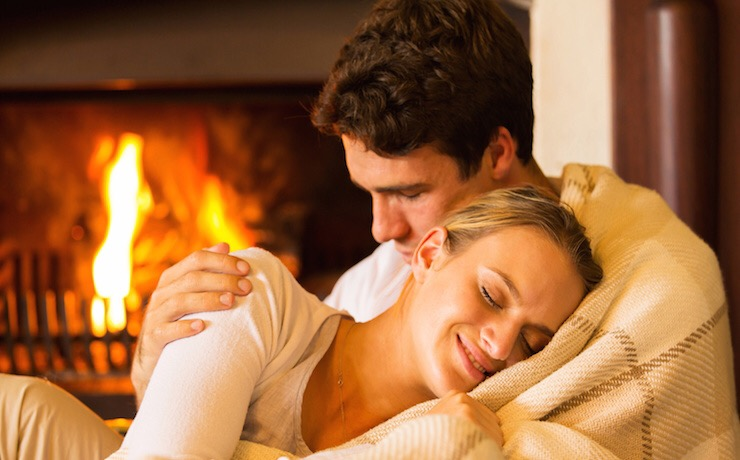 beautiful couple relaxing at home on a cold winter day