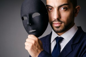 bigstock-Man-with-black-mask-March-36-300x198